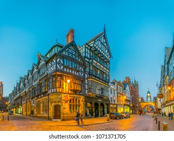 CHESTER, UNITED KINGDOM, APRIL 7, 2017: Sunset view of traditional tudor houses alongside the Eastgate street in the central Chester, England