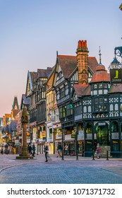 CHESTER, UNITED KINGDOM, APRIL 7, 2017: Sunset view of traditional tudor houses alongside the Bridge street in the central Chester, England