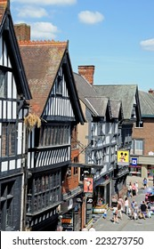 CHESTER, UNITED KINGDOM - JULY 22, 2014 - Elevated view of the Tudor shops along Eastgate Street, Chester, Cheshire, England, UK, Western Europe, July 22, 2014.