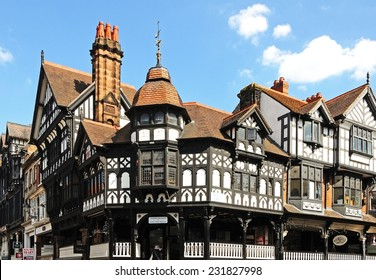 CHESTER, UNITED KINGDOM - JULY 22, 2014 - The rows shops on the corner of Eastgate Street and Bridge Street, Chester, Cheshire, England, UK, Western Europe, July 22, 2014.