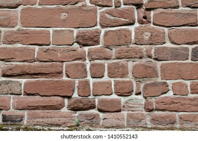 Chester, United Kingdom. May 25 2019. The brick wall texture. This Wall is the example of 11th–12th century church bricks pattern in Chester, England.