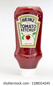 CHESTER, UNITED KINGDOM - SEPTEMBER 22ND 2018: Squeezable bottle of Heinz Tomato ketchup on a white background