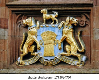 "CHESTER,CHESHIRE WEST AND CHESTER,UK – JULY 11, 2019: Coat of arms visible on the exterior of a building in Eastgate Street. The translation for ""Virtus non stemma"" Latin motto is ""Valor, not garland"""
