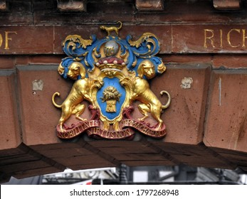 CHESTER,CHESHIRE,UK – JULY 11,2019: Arms of Richard Lord Grosvenor on outer keystone of the Chester's Eastgate wall. The motto is in Latin and it means: 'VIRTUE, NOT PEDIGREE, IS THE MARK OF NOBILITY'