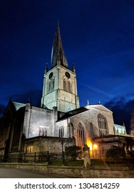 """CHESTERFIELD, ENGLAND - FEBRUARY 4, 2019: Exterior of Church of St Mary and All Saints (also known as """"The Crooked Spire"""") at night, Chesterfield, UK"""