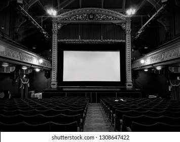 CHESTERFIELD, ENGLAND - FEBRUARY 4, 2019: Rows of traditional, vintage seats and cinema screen at the Victorian Pomegranate Theatre, The oldest Civic theatre in the UK, Chesterfield, UK