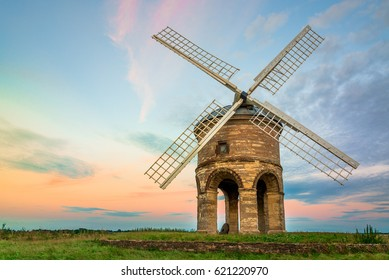 Chesterton Windmill, a 17th-century cylindrical stone tower mill with an arched base, under a sunset sweet sky, in Warwickshire, West Midlands, UK.