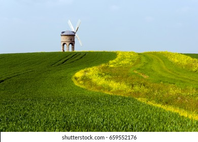 Chesterton Windmill, built in 1632 above Wheat and Rapeseed field in Warwick England.