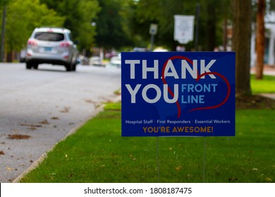 """Chestertown, MD, USA 08-30-2020:  close up image of a beautiful yard sign by the street that says """"Thank you' to all front line health care workers for their efforts during the COVID-19 pandemic."""