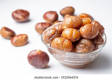 Chestnut dessert and chestnuts on a plate. Traditional delicious Turkish dessert; chestnut candies (Kestane Sekeri)