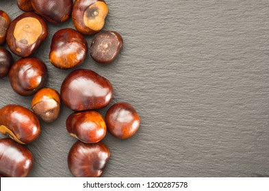 chestnut fruits are located on a slate dish top view