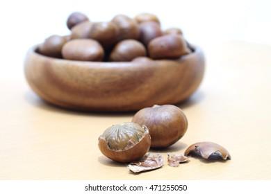 chestnut on wooden background