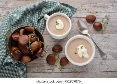 Chestnut soup on wood background