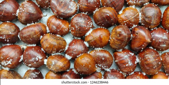 Chestnuts on salt ready to go to the oven.