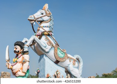 Chettinad, India - October 16, 2013: Combination of Ayyanar and his horse against blue skies. Ayyanar is the village protector, here the Kadiapatti village.
