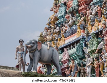 Chettinad, India - October 17, 2013:Detail of the Shiva temple gopuram at Kottaiyur shows Lord Shiva as supreme teacher and elephant walking away. Plenty of colorful statues.