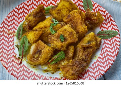 Chettinad  Meen Varuval,Chettinad style fried fish,  Kerala Style cuisine, Traditional assorted dishes, Top view.