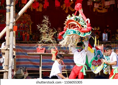 "Cheung Chau, Hong Kong - 22 May 2018: Bun Festival Committees performing traditional ""Qilin"" (a mythical creature) dance at the street to celebrate the festival."