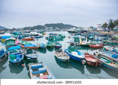 CHEUNG CHAU,HONG KONG-MARCH 14,2016:Crowded fishing harbor in Cheung Chau, Cheung Chau is an island in Hong Kong, Which attracts thousands of local and overseas tourists every year
