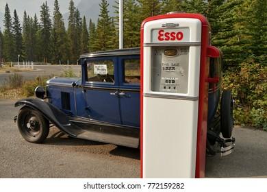 Chevrolet historic car and old gasoline pump Esso. Banff National Park, Alberta, Canada. 20 September 2017
