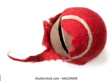 chewed red ball on a white background. dog toy. concept of Pets