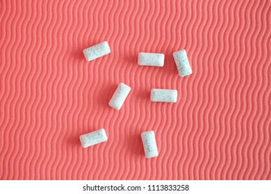Chewing gum on pink background