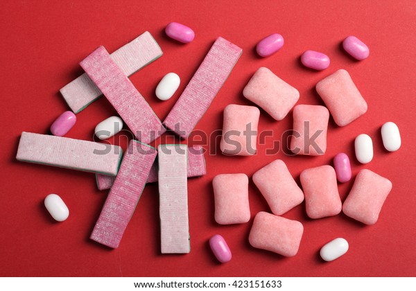 chewing gum on a red background