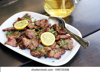Chewing pork grilled traditional Portuguese dish.