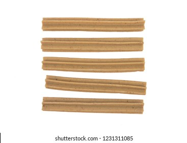 Chewing sticks for dogs on white background