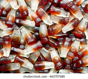 Chewy Cola Bottle background a popular retro sweet also known as Gummy candy at a pick and mix self service market.