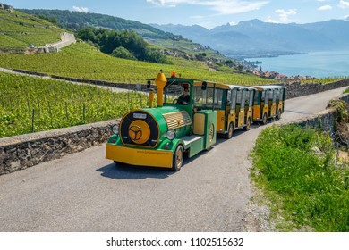 CHEXBRES, SWITZERLAND - MAY 25, 2018: A tourist train crosses the slopes of the Lavaux wine region near Chexbres in Switzerland on May 25, 2018