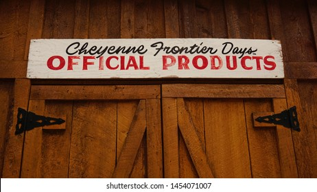 Cheyenne, Wyoming - July 2, 2019: Cheyenne Frontier Days Official Products sign on dark brown wooden building. Started in 1897, CFD is the world's largest outdoor rodeo and western celebration.