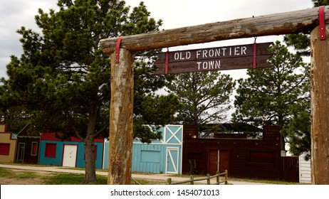 Cheyenne, Wyoming - July 2, 2019: Cheyenne Frontier Days Old Frontier Town sign entrance with town in background. Started in 1897, CFD is the world's largest outdoor rodeo and western celebration.