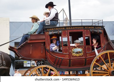 Cheyenne, Wyoming - July 27, 2019: A  Concord coach from the Cheyenne and Black Hills Stage and Express Line in a Cheyenne Frontier Days parade, operating from Cheyenne to Deadwood, Dakota Territory.