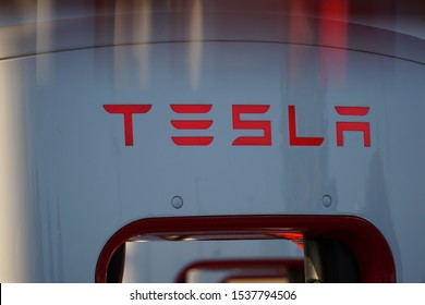 Cheyenne, Wyoming - October 7, 2019: Close up of one of four Tesla Superchargers up to 120kW, available 24/7, located at Frontier Mall on Dell Range Blvd. Logo shown with cool reflection effect.