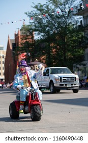 Cheyenne, Wyoming / United States of America - July 21, 2018. A rodeo clown rides down the street in Cheyenne, Wyoming as part of the Frontier Days opening day parade.