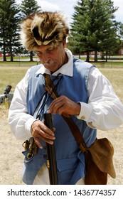 Cheyenne, Wyoming / USA - Circa July 2010 Demonstration on loading and operating a flintlock rifle.