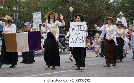 Cheyenne, Wyoming, USA - July 27, 2019: Women celebrating the 150th year anniversary of the right to vote in Cheyenne Frontier Days parade. The Wyoming Territory was the first to allow women to vote.