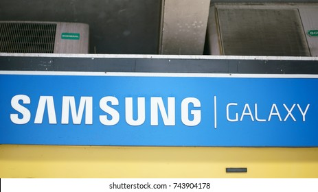 Chhatrapati Shivaji Terminus Area, Fort, Mumbai, Maharashtra, India - October 25, 2017 - A closeup of the trademark brand logo of Samsung company hanging outside a store.