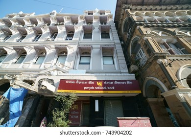 Chhatrapati Shivaji Terminus Area, Fort, Mumbai, Maharashtra, India - October 25, 2017 - A closeup of the trademark brand logo of Punjab National bank hanging outside their office building.