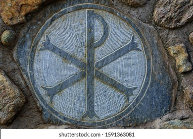"""""""Chi Rho"""" Symbol carved on stone in stone wall of The Great Meteoron Holy Monastery of the Transfiguration of the Savior. Chi Rho Symbol is an ancient Christian symbol meaning """"Christ"""""""