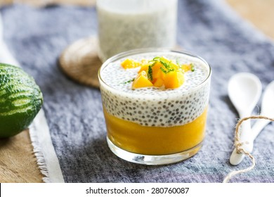 Chia in homemade soy milk with mango puree and mango chunk