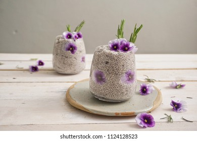 Chia pudding with edible flowers ( pansies )