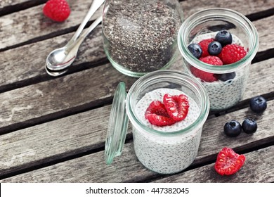 Chia pudding with fresh raspberries and honey. Superfoods concept.Selective focus.