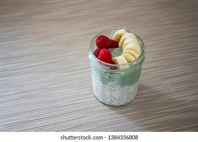 Chia pudding with matcha tea, raspberry and banana