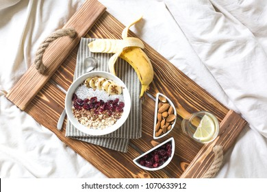 Chia pudding with nuts and fruits. Breakfast in bed on a tray. View from above.