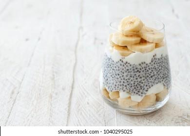 Chia pudding parfait, layered with banana and yogurt