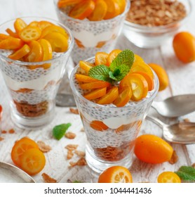Chia pudding parfait, layered with kumquat  and granola