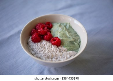 Chia pudding with spirulina yogurt and raspberry