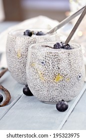 Chia seed pudding made with mangoes and blueberries with extreme shallow depth of field.